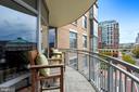 Spacious wraparound balcony perfect for cocktails! - 11990 MARKET ST #413, RESTON