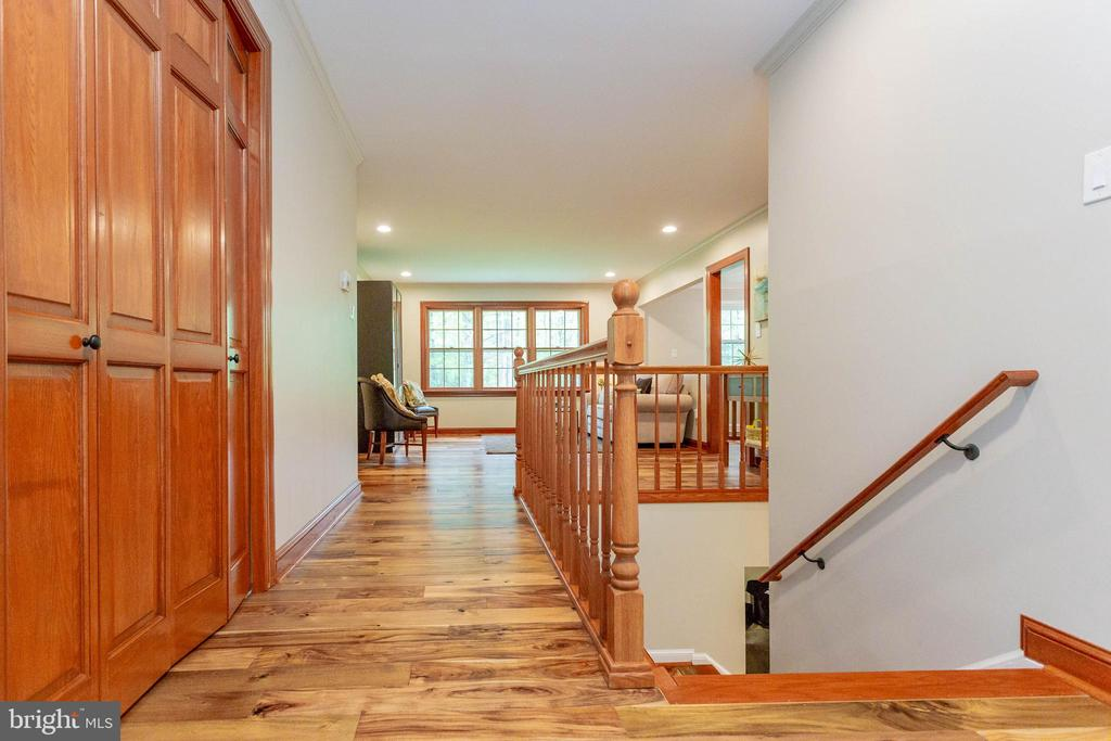 Gorgeous Walnut flooring in the foyer - 11905 CHAPEL RD, CLIFTON