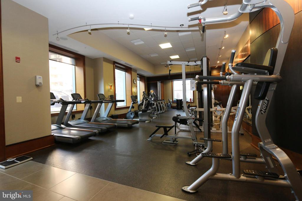 A gym and massage area - 11990 MARKET ST #1403, RESTON