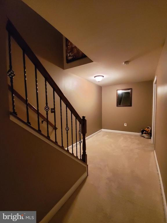 Spacious stairs and hallways continue downstairs. - 4152 AGENCY LOOP, TRIANGLE