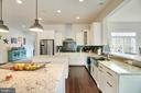 Gourmet kitchen with large island and bar seating - 21 GLENVIEW CT, STAFFORD