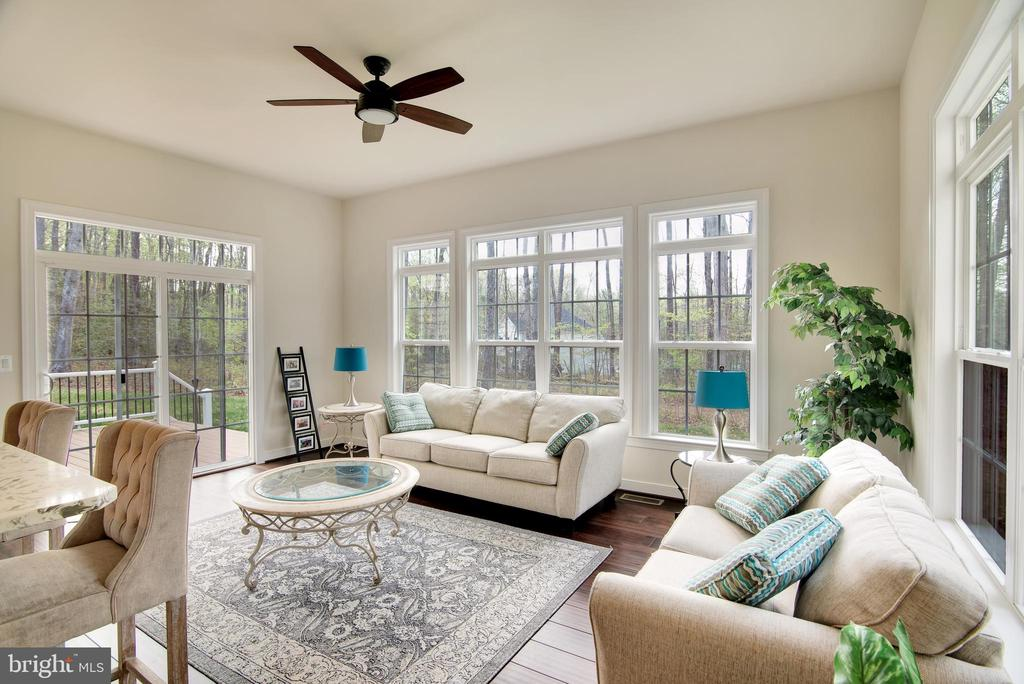 Rear sun room with a ceiling fan and natural light - 21 GLENVIEW CT, STAFFORD