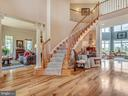 Exceptional foyer with cathedral height ceilings. - 7803 PICNIC WOODS RD, MIDDLETOWN