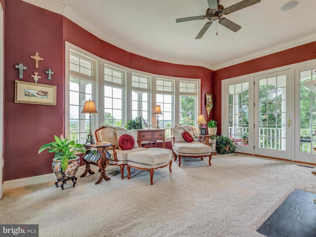 Morning coffee in the conservatory. - 7803 PICNIC WOODS RD, MIDDLETOWN