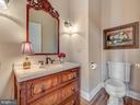 Powder room with antique sink. - 7803 PICNIC WOODS RD, MIDDLETOWN