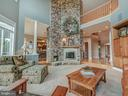 Stone fireplace drama with access on both sides. - 7803 PICNIC WOODS RD, MIDDLETOWN