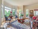 Formal living room with a beautiful bay window. - 7803 PICNIC WOODS RD, MIDDLETOWN
