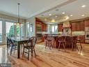 Open kitchen morning room with access to deck. - 7803 PICNIC WOODS RD, MIDDLETOWN