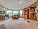 Lower level entertaining with stone fireplace - 7803 PICNIC WOODS RD, MIDDLETOWN