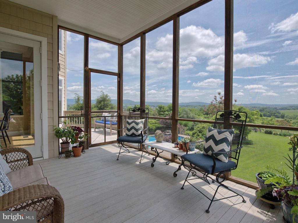 Screened porch with stunning views. - 7803 PICNIC WOODS RD, MIDDLETOWN