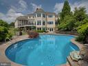 Sparkling pool with a stone fountain. - 7803 PICNIC WOODS RD, MIDDLETOWN