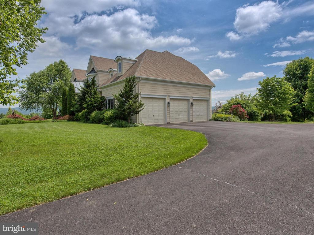 Three car garage with plenty of storage. - 7803 PICNIC WOODS RD, MIDDLETOWN
