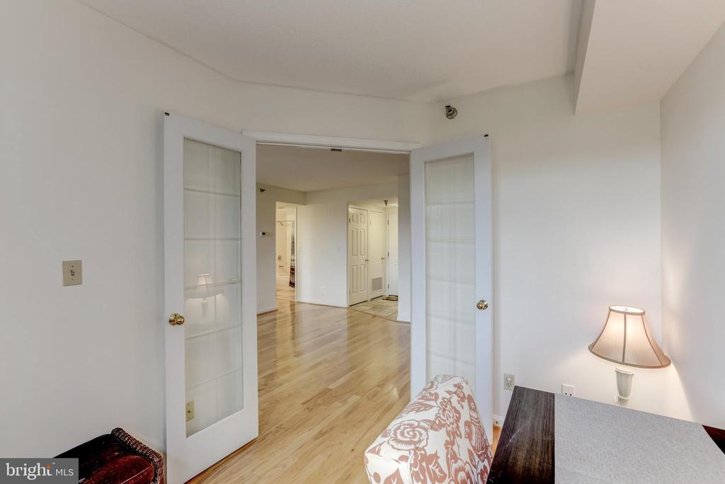French doors lead into the den - 2400 CLARENDON BLVD #803, ARLINGTON