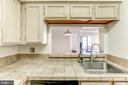 Kitchen with a pass-through window - 2400 CLARENDON BLVD #803, ARLINGTON