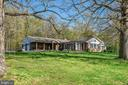 Main residence is beautifully sited atop a knoll - 43470 EVANS POND RD, LEESBURG