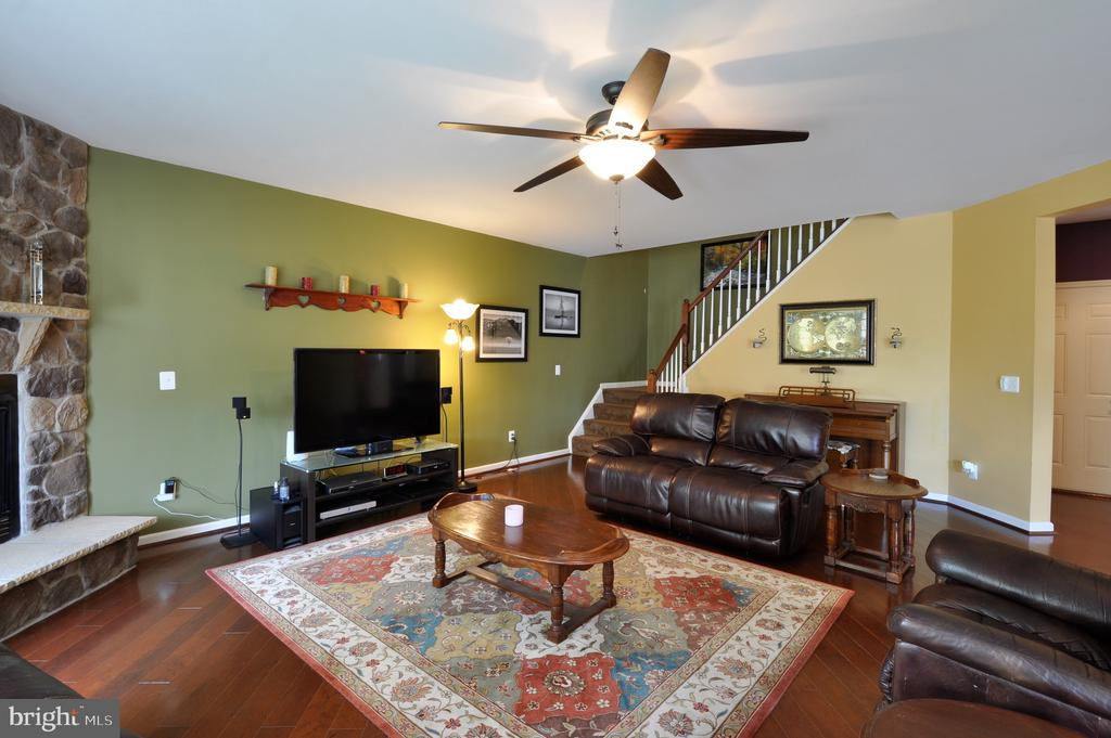 HUGE Family room, wood floor laid on the diagonal - 61 CHAPS LN, FREDERICKSBURG