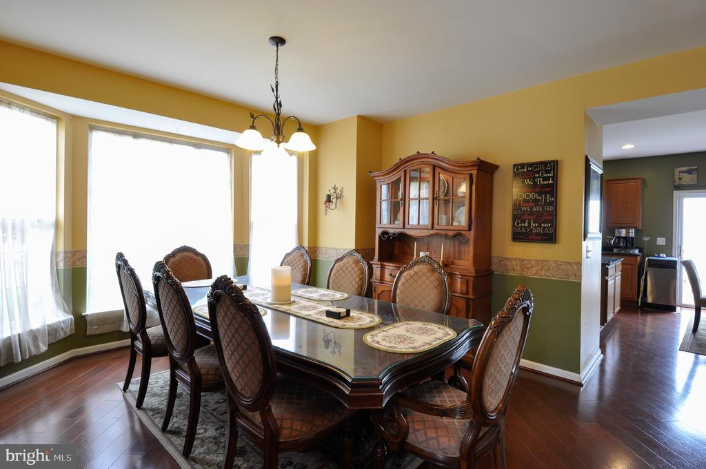 Formal dining room with bay window - 61 CHAPS LN, FREDERICKSBURG