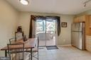 Kitchen with sliding doors to deck - 9637 LAMBETH CT, COLUMBIA