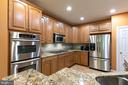 kitchen w.maple cabinets, stainless appliances - 47643 PAULSEN SQ, STERLING