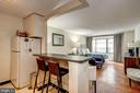 Interior open kitchen to living space - 1301 20TH ST NW #201, WASHINGTON