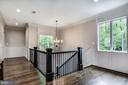 Wide wooden staircase w/ 2-story picture window - 5029 38TH ST N, ARLINGTON