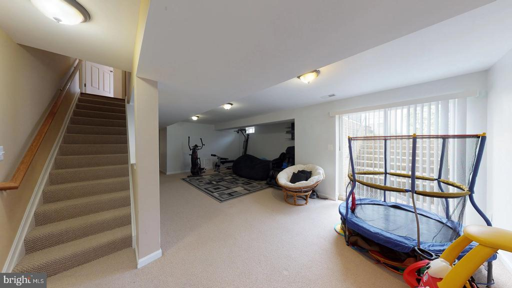 Walk out lower level offers a rec room - 31 MINERAL SPRINGS, RANSON