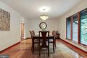 Formal dining room with vintage fixture - 11220 HANDLEBAR RD, RESTON