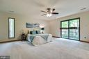 Master bedroom with slider over looking coi pond - 11220 HANDLEBAR RD, RESTON