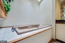 Tub lit with natural light through the skylights - 11220 HANDLEBAR RD, RESTON