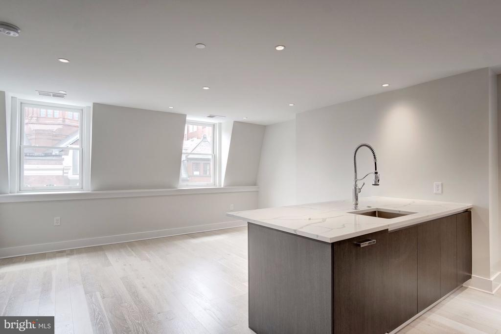 Spacious living area with views of St. Matthew's! - 1745 N ST NW #414, WASHINGTON