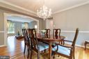 Arched entry, chair rail and crown molding - 12904 CHALKSTONE CT, FAIRFAX