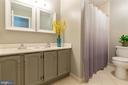 Upper hall bathroom with dual vanities - 12904 CHALKSTONE CT, FAIRFAX