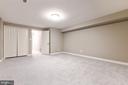 Lower level den with closet storage - 12904 CHALKSTONE CT, FAIRFAX