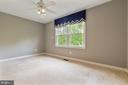 Bedroom 4 over looks rear yard - 12904 CHALKSTONE CT, FAIRFAX