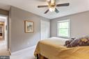 Bedroom 2 over looks back yard - 12904 CHALKSTONE CT, FAIRFAX