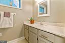 Lower level full bathroom with tub/shower - 12904 CHALKSTONE CT, FAIRFAX