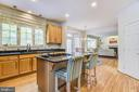 Great gatherings happen around a kitchen island - 7428 SPRING SUMMIT RD, SPRINGFIELD