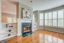 Wood burning fireplace with custom built in. - 5429 CASTLE BAR LN, ALEXANDRIA