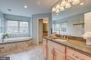 Elegantly updated master bathroom - 5429 CASTLE BAR LN, ALEXANDRIA