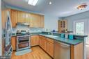 Gourmet kitchen with stainless steel appliances - 5429 CASTLE BAR LN, ALEXANDRIA