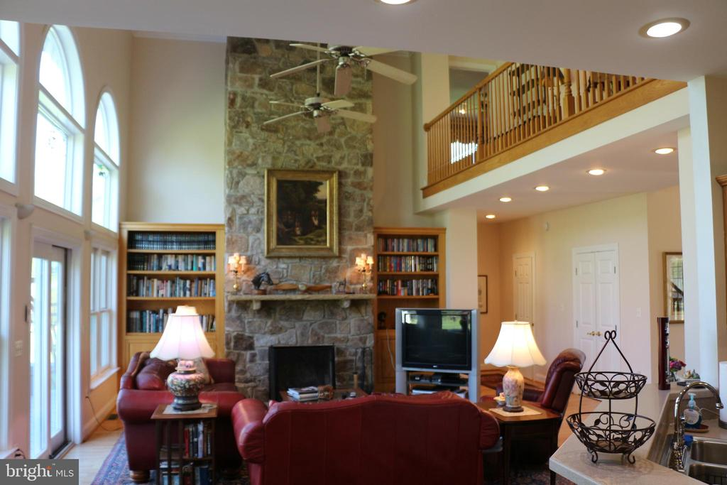 Great room with floor to ceiling stone fireplace - 18561 YELLOW SCHOOLHOUSE RD, ROUND HILL