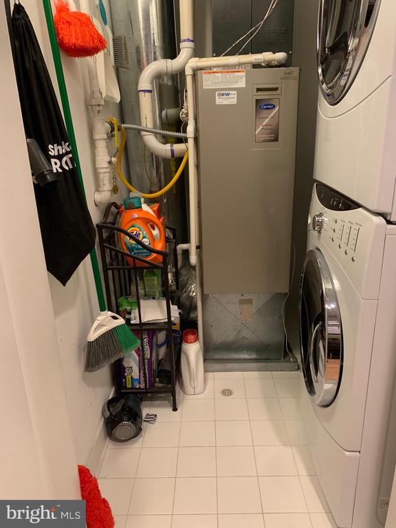 Stacked washer/dryer and extra storage. - 3800 LEE HWY #301, ARLINGTON