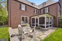 Large back yard with fieldstone patio - 104 TUNBRIDGE RD, BALTIMORE