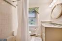 Upper level full bath with porcelain tile - 104 TUNBRIDGE RD, BALTIMORE