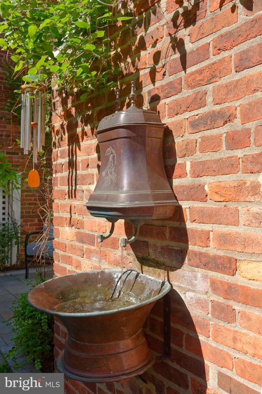 The fountain is an antique copper lavabo - 209 S SAINT ASAPH ST, ALEXANDRIA