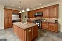 Appointed with cherry cabinetry & granite counters - 209 S SAINT ASAPH ST, ALEXANDRIA