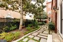 The side yard has walking stones from the parking - 209 S SAINT ASAPH ST, ALEXANDRIA