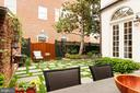 The lovely garden and patio are adorned with roses - 209 S SAINT ASAPH ST, ALEXANDRIA