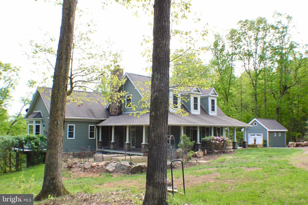 Fro view of  showing wrap around mahogany covered - 20970 STEPTOE HILL RD, MIDDLEBURG