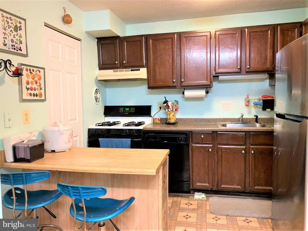 Kitchen with Island - 7360 LEE HWY #101, FALLS CHURCH
